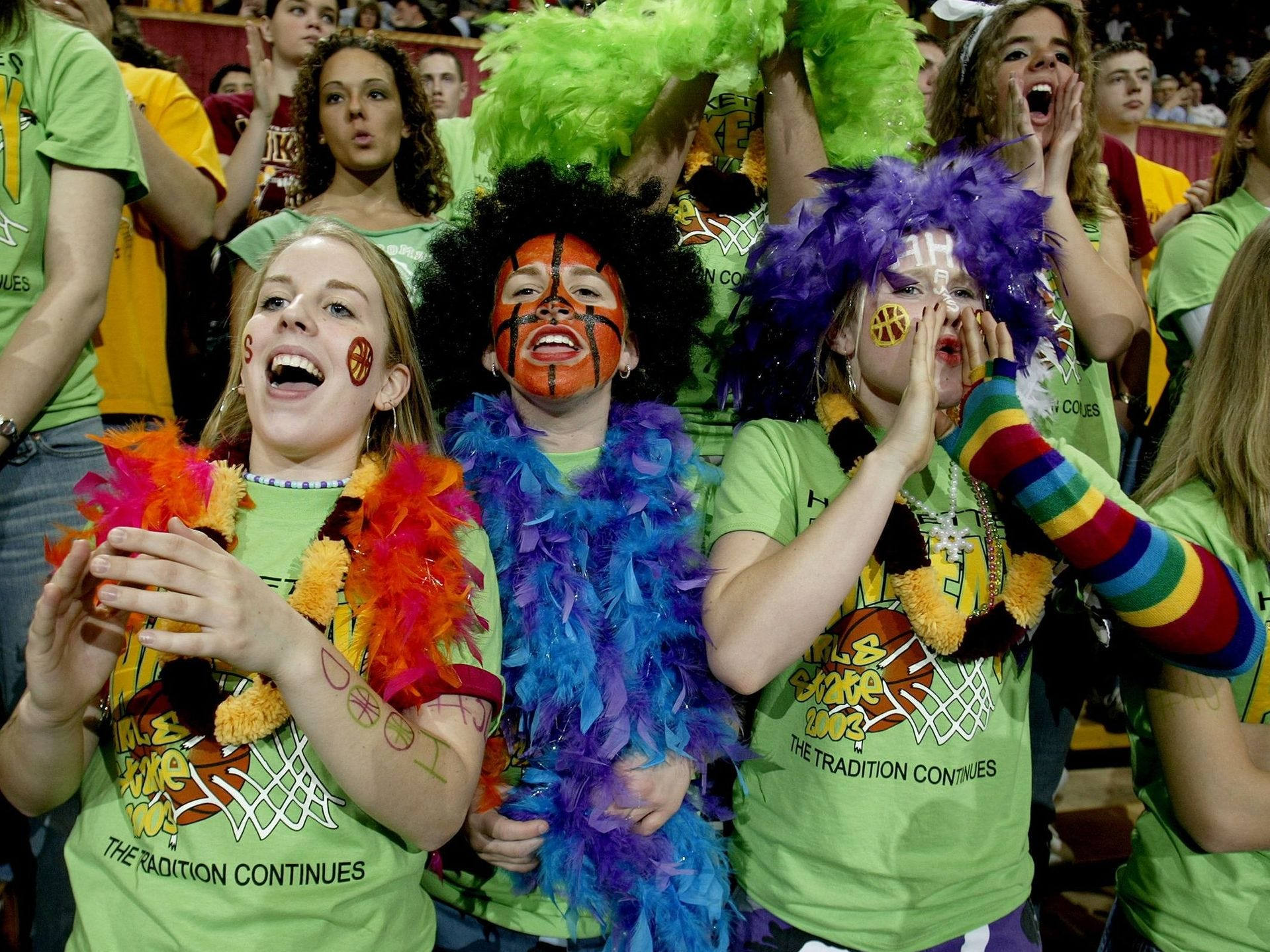 2003: Ankeny fans cheer their team to victory over North Scott of Eldridge in a Class 4-A quarterfinal game at the state girls' basketball tournament at Veterans Memorial Auditorium. From left are Kaci Dannatt, Heather Hill and Ashlee Drake. Register file photo