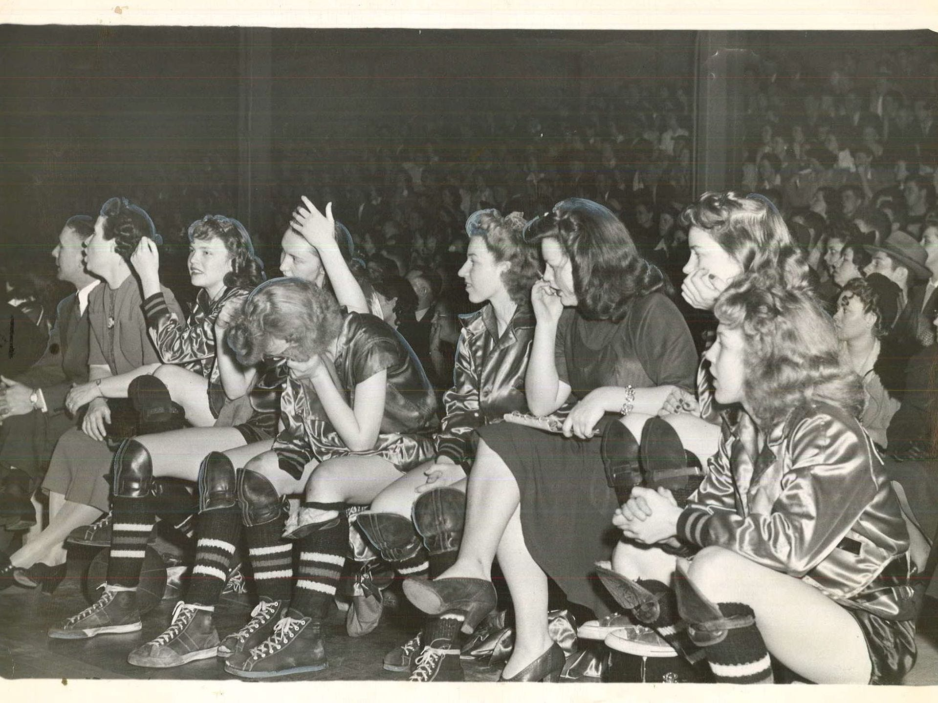 1944: The Gowrie girls bench watches their team fall behind at the close of state girlsÕ basketball tournament game at Drake Fieldhouse. Register file photo