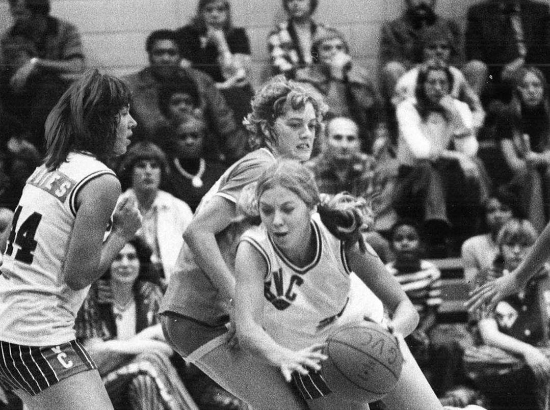1975: GUC #32 Molly Van Benthuysen picks up a charging foul by running into Seminole's Sherri Hudlow at the state girls' basketball tournament. Register file photo