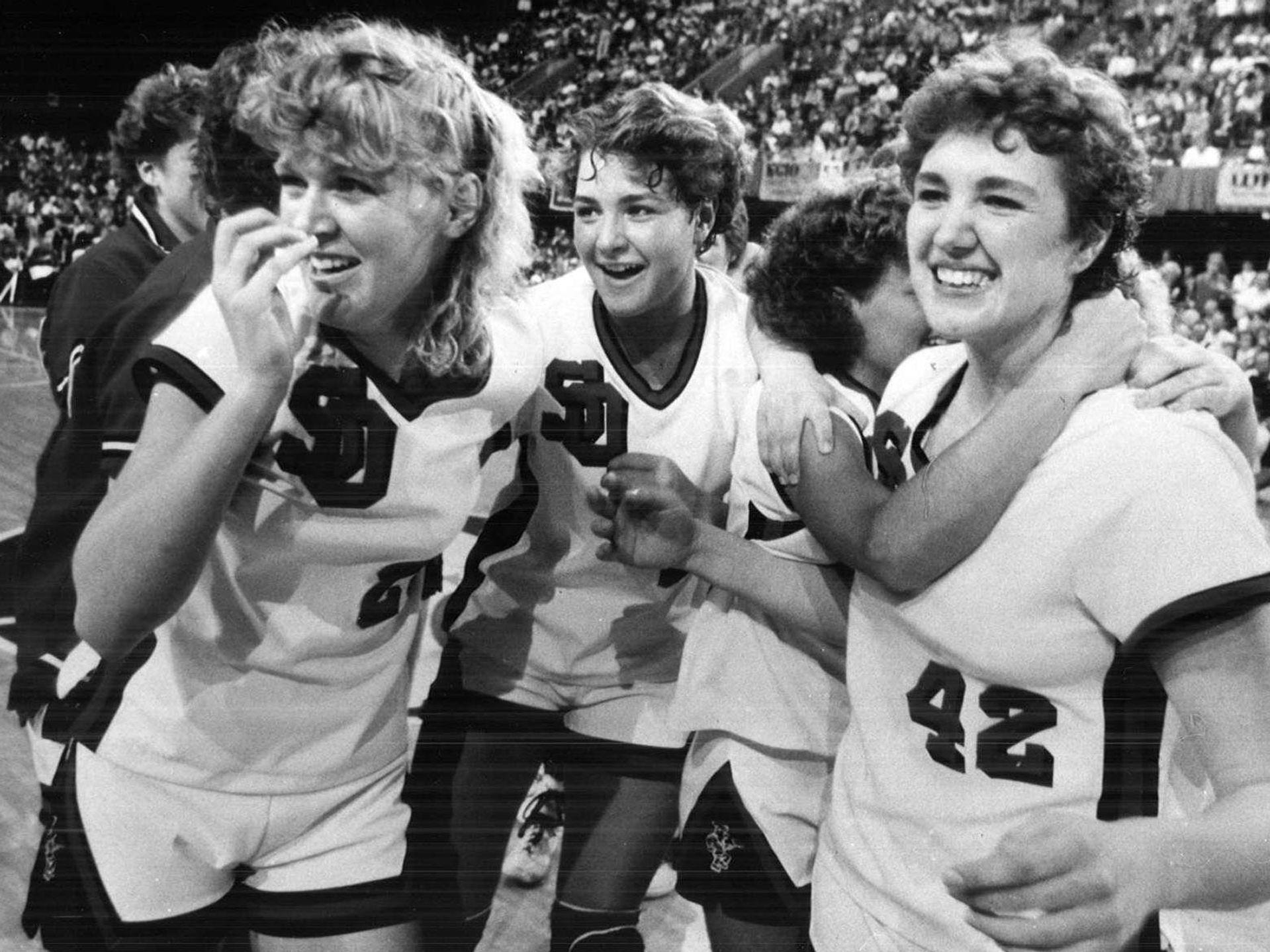 1986: Tami Bellows, Lynette Gruis and Stacy Doeden relish victory by Sibley-Ocheydan over Panora-Linden. Register file photo