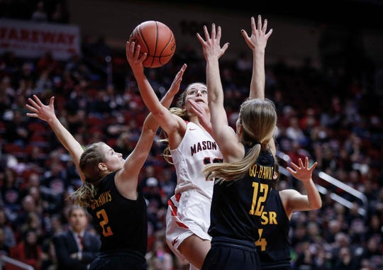 Mason City senior Megan Meyer slices between a pair of Waverly-Shell Rock defenders en route to a field goal in their 4A state quarterfinal game on Tuesday, Feb. 26, 2019, at Wells Fargo Arena in Des Moines.