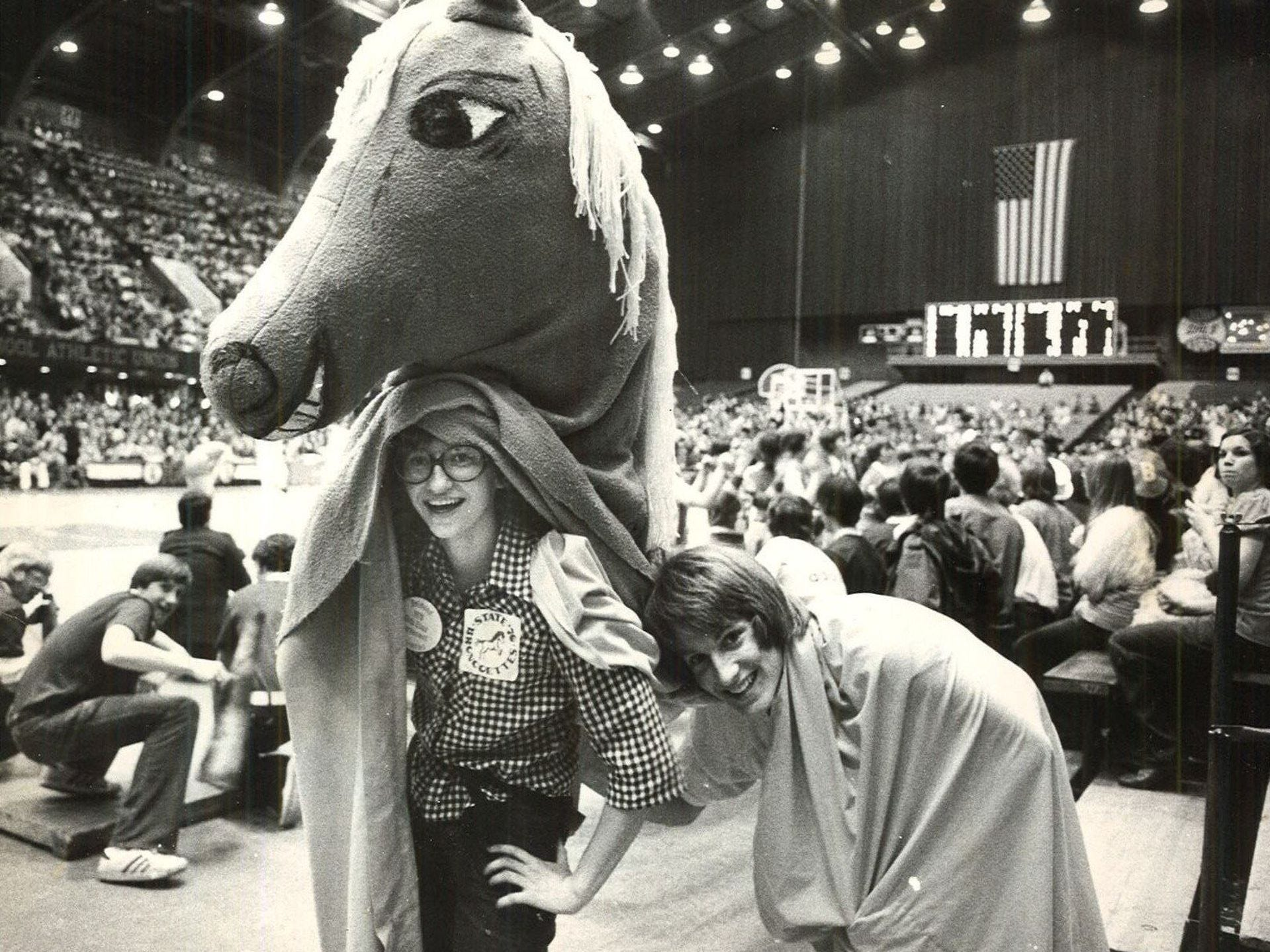 1976: Jane Jacobmeyer, 15, left, and Jay Gabrielson, 16, get a breath of fresh air after being the Belmond High School bronco mascot during the opening round of the state girls' basketball tournament at Veterans Memorial Auditorium. Belmond lost, 86-65. Register file photo