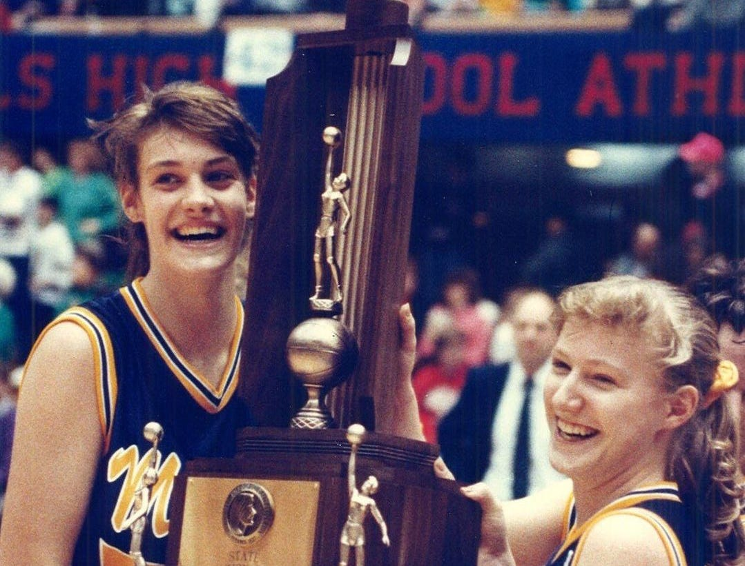 1991: Jenny Noll, left, and Jana Hovick, of Muscatine, celebrate after defeating Cedar Rapids Kennedy, 68-53, in a consolation game at the state girls' basketball tournament. Register file photo
