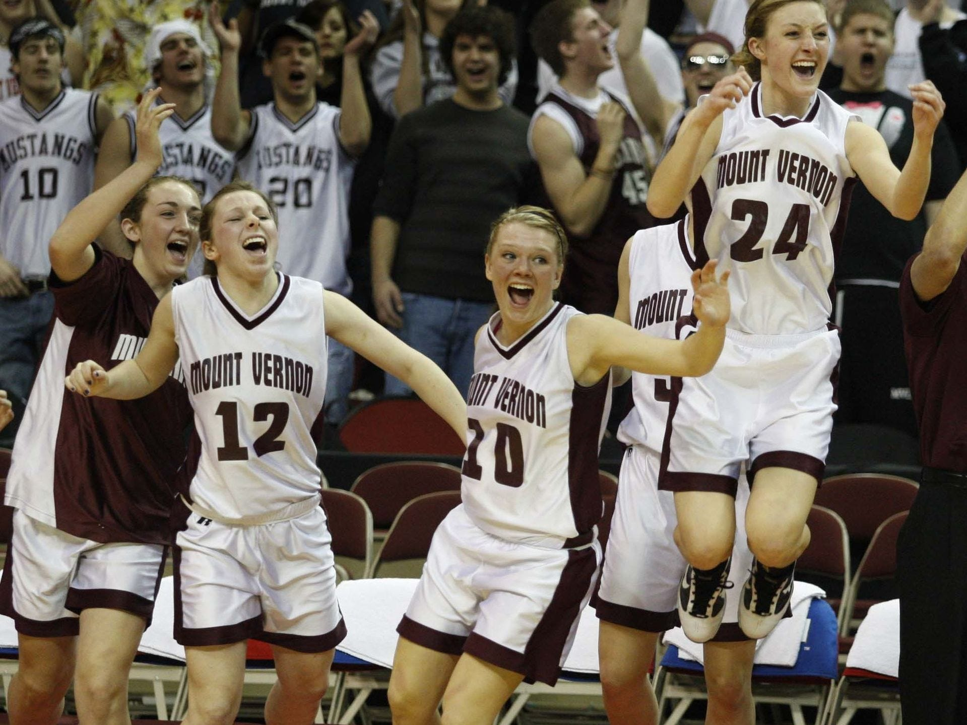 2010: Mount Vernon's Sarah Ryan (12), Kylea Weber (10) and Courtney Kintzel (24) leap for joy as the time runs out in their 2-A semifinal win against Roland-Story. Register file photo