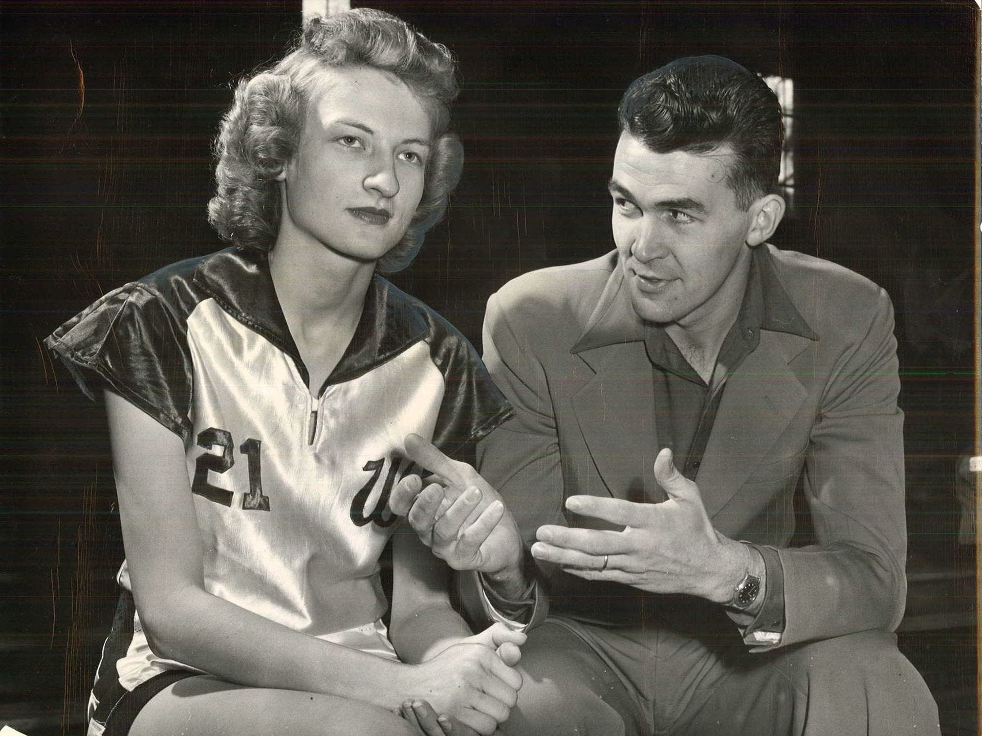 1949: One of the best guards in the state, Thelma Ross, listens to her coach Fred Heerema during the state girlsÕ basketball tournament. Register file photo