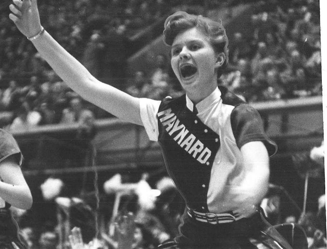 1957: Maynard cheerleader Karen Potratz cheers for her team following a victory over Guthrie Center during the state girlsÕ basketball tournament. Register file photo