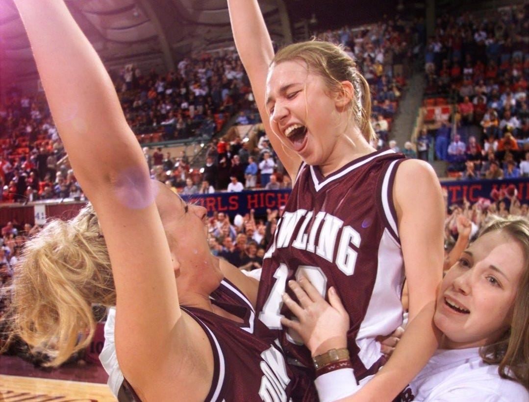 2000: Dowling players Cristen Slings, left, Angela Korte, center, and Ali Markun celebrate after winning the state Class 4-A girls' basketball title. Dowling defeated Cedar Falls, 36-35. Register file photo