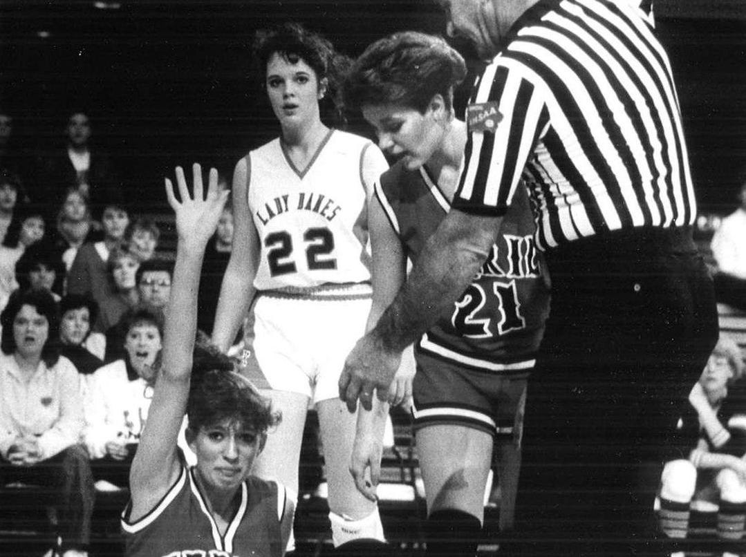 1987: Terril's Natalie Sidels regretfully acknowledges committing a foul. Teammate Darci Houseman, right, and the Lady Danes' Dawn Hoegh watch. Register file photo
