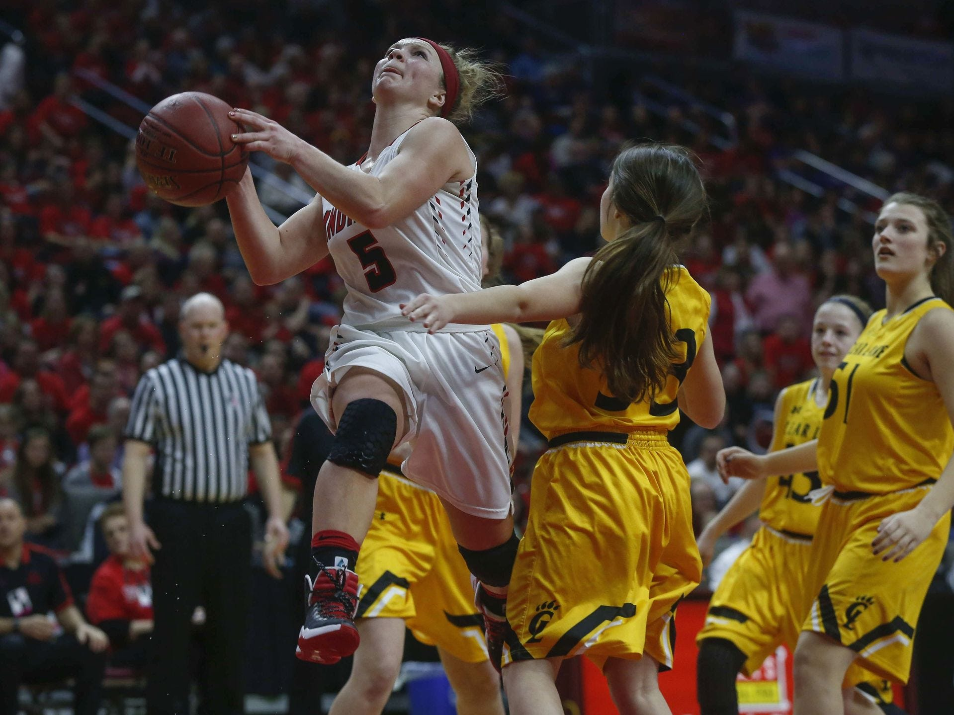 Pocahontas Area senior Elle Ruffridge moves through traffic against Clear Lake on Tuesday, Feb. 28, 2017, at Wells Fargo Arena in Des Moines. Bryon Houlgrave/Register file photo