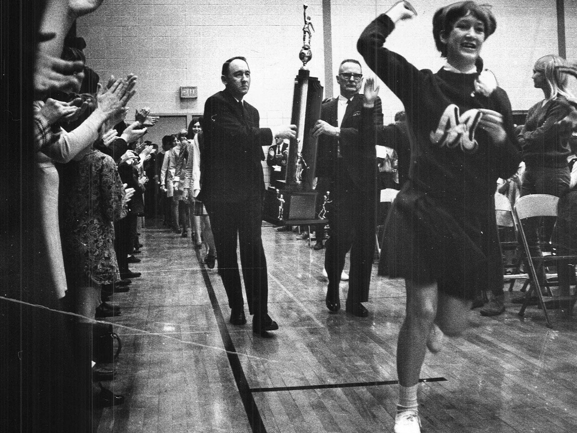 1969: Close to 2,500 fans packed the Montezuma High School gymnasium in March 1969 to celebrate the school's first state girls' basketball tournament championship. The Saturday night title game that saw Montezuma beat Allison-Bristow 66-60 was followed by a caravan that picked up hundreds of cars on its way from Des Moines to Poweshiek County. Register file photo