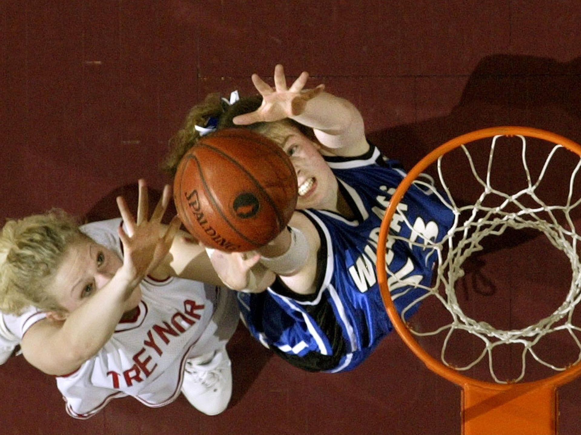 2004: Rockwell City's Felicia Ellis grabs a rebound over a Treynor player in the second half of their 1A game in the state girls' basketball tournament. Register file photo