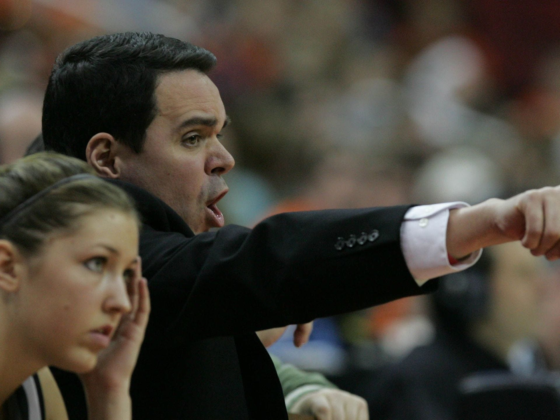 2009: Springville's coach Brian O'Donnell yells to players in the final minute of their win over Martensdale-St. Marys in their 1A quarterfinal at the state girls' basketball tournament. Register file photo