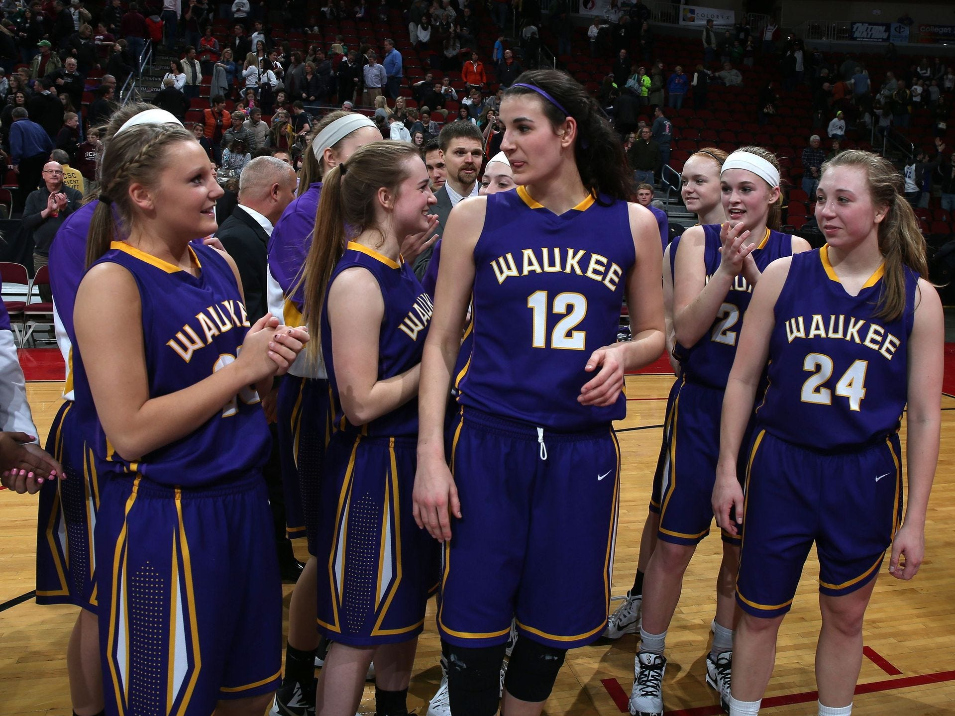 Members of the Waukee girls basketball team celebrate after a win over Dowling Catholic on Friday, March 6, 2015, during the 5A girls semifinals at the 2014-15 Iowa girls basketball tournament in Des Moines. Bryon Houlgrave/The Register