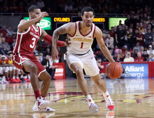 Iowa State Cyclones guard Nick Weiler-Babb (1) drives past Oklahoma Sooners guard Miles Reynolds (3) at Hilton Coliseum.