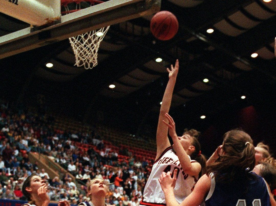 1997: Caroll's Kim McCaffrey sinks the winning basket to hand the Tigers the Class 3-A title, 50-49. Register file photo