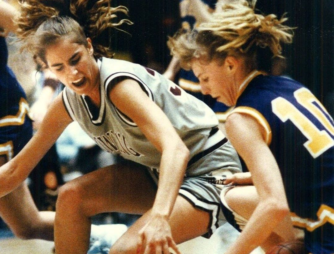 1992: Dowling's Julie Nahas scrambles for a loose ball with Indianola's Sara Riemersma during the state girls' basketball tournament. Dowling won. Register file photo