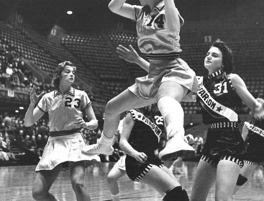 1961: Virgina Schubert is all business as she grabs the rebound during VenturaÕs first-round victory over Pekin in the state girlsÕ basketball tournament. Register file photo