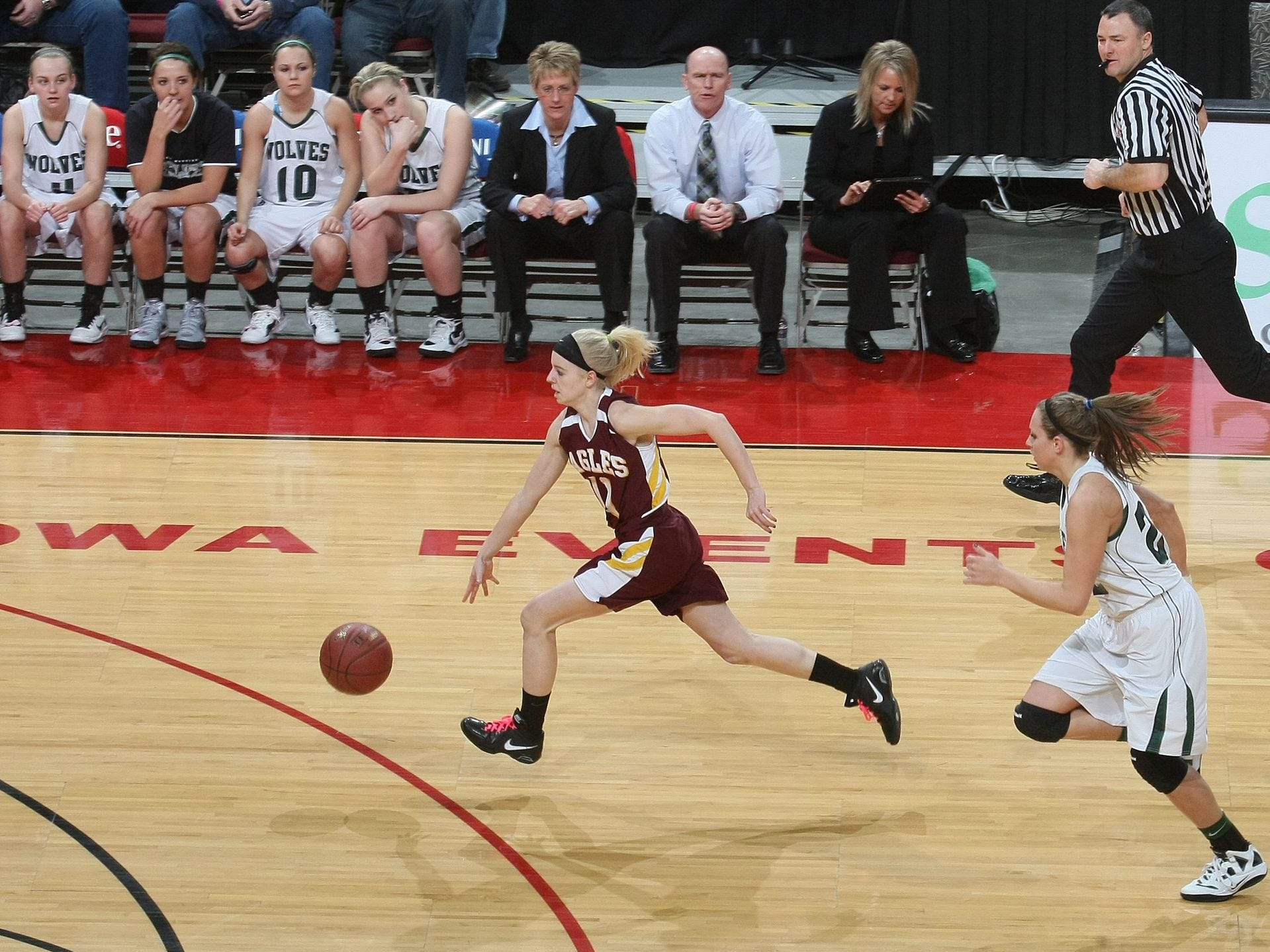 2012: Pella Christian's Jasmin Schelhaas makes a fast break to the basket, trailed by IKM-Manning's Tember Schechinger in their 2A semifinal at the state girls' basketball tournament. Register file photo