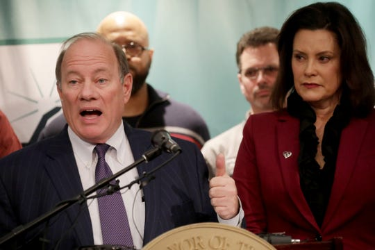 Detroit Mayor Mike Duggan speaks as Gov. Gretchen Whitmer looks on during an press conference to announce a an investment of $4.5 billion by FCA with plans to open  Jeep factory in Detroit on Tuesday, February 26, 2019.