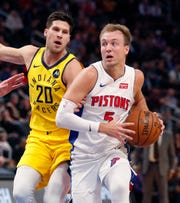 Detroit Pistons guard Luke Kennard drives against Indiana Pacers forward Doug McDermott during the first half Monday, Feb. 25, 2019, in Detroit.