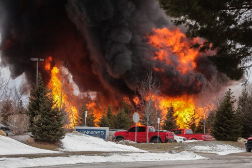 Auburn Hills Fire Department a battles blaze behind US Farathane Corporation building in Auburn Hills on Tuesday, February 26, 2019