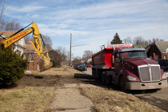 The Chicago-based McDonagh Demolition excavates a demolition site in the 13000 block of Maiden St. on Detroit's east side on Friday, Feb. 22, 2019.