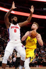 Domantas Sabonis drives against Andre Drummond in the second quarter at LCA.