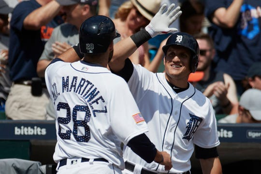 Tigers outfielder Mikie Mahtook (right) says he is working to get a better understanding of his swing, much like former teammate J.D. Martinez (28) did while in Detroit.