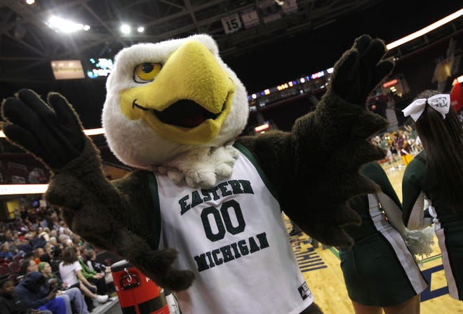Eastern Michigan has settled a Title IX lawsuit with two athletes, agreeing to pay a former softball player $100,000 and a tennis player $25,000 as well as their legal fees.