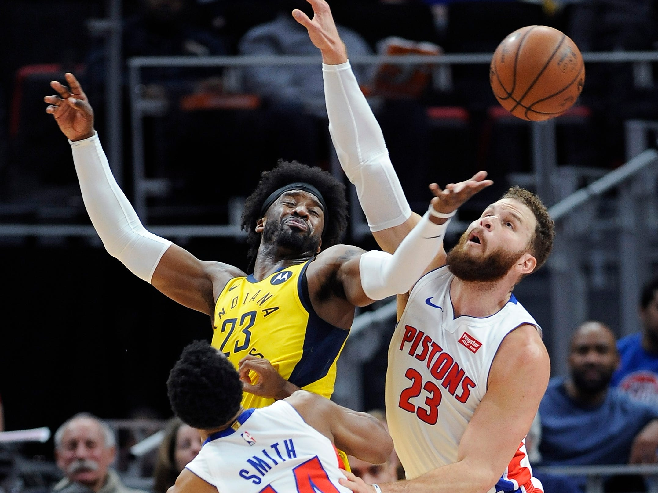 Indiana's Wesley Matthews battles Detroit's Blake Griffin for a loose ball in the first quarter. Griffin had 20 points, 10 rebounds and 10 assists in a 113-109 victory Monday, Feb. 25, 2019, at Little Caesars Arena in Detroit.