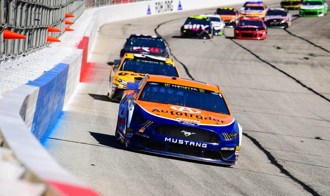 Brad Keselowski leads a row of cars at Atlanta Motor Speedway.