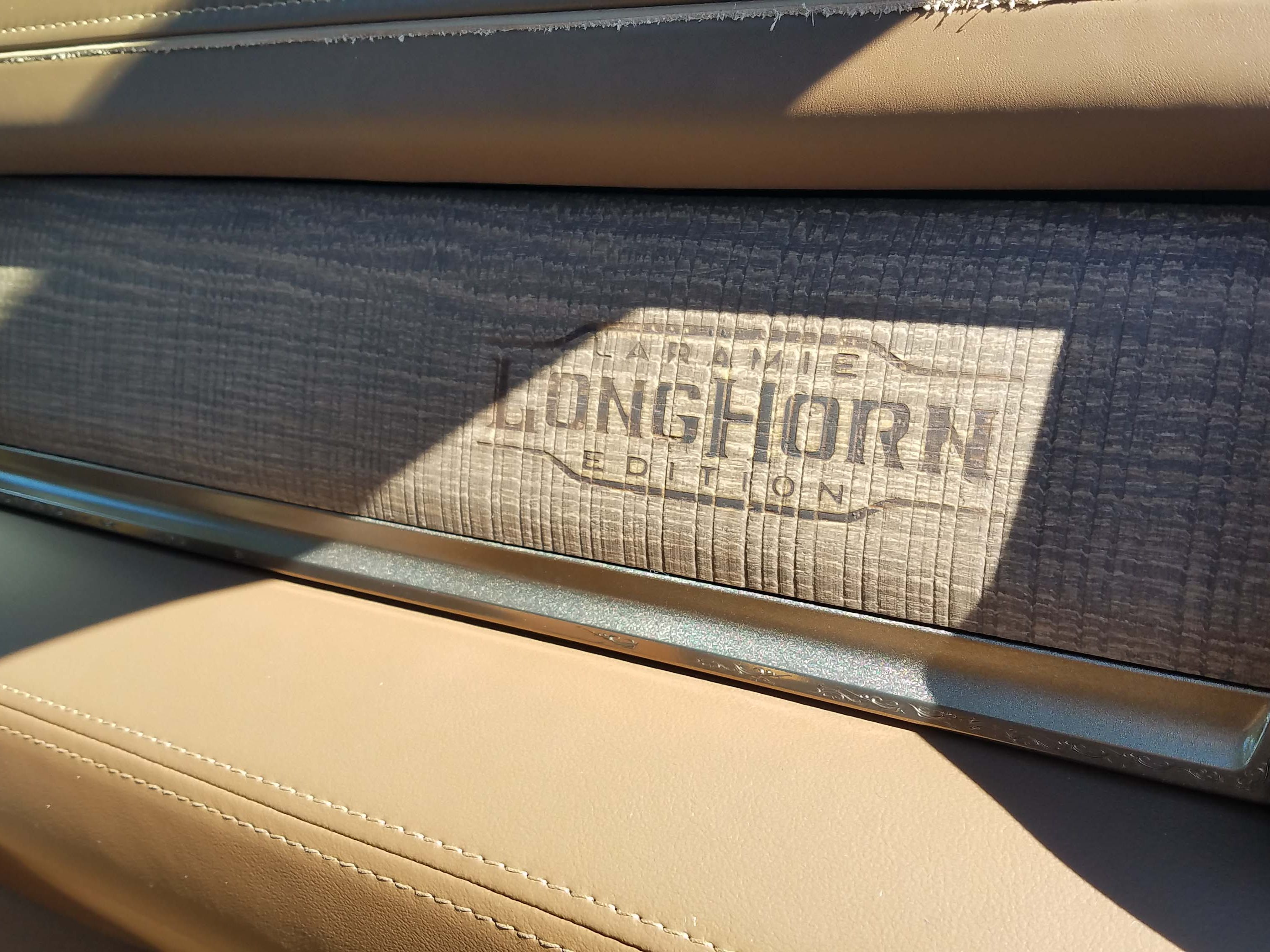 "The interior of the Ram 3500 Heavy Duty pays careful attention to detail, like this branded logo on the dash of the ""Longhorn"" model."
