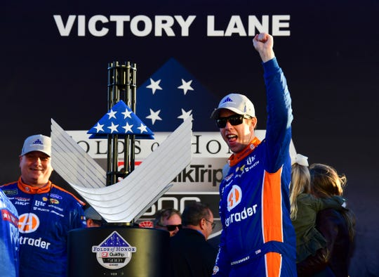 Brad Keselowski celebrates in Victory Lane after winning Sunday.