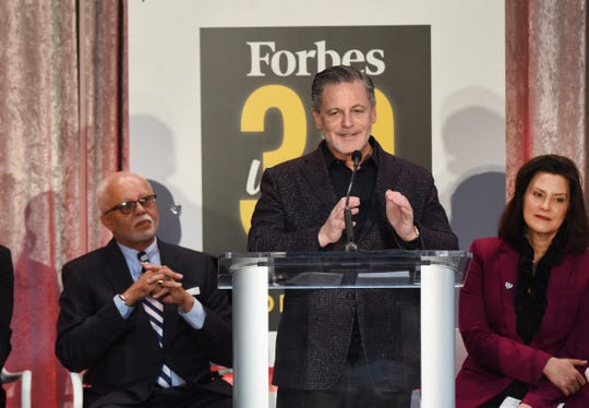 Quicken Loans Founder and Chairman Dan Gilbert speaks, with Wayne County Executive Warren Evans (left) and Michigan Gov. Gretchen Whitmer looking on.