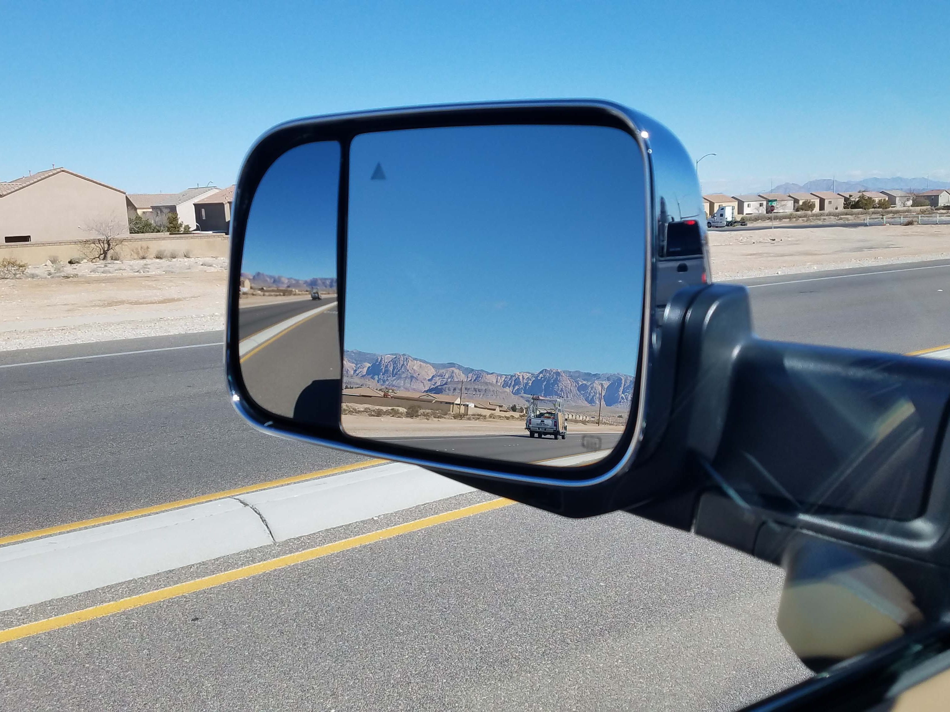 The Ram 3500 Heavy Duty boasts a versatile side mirror, with both panes controllable from inside the cab.
