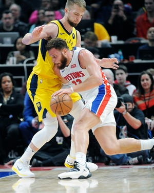 Blake Griffin drives around the Pacers' Domantas Sabonis in the third quarter Monday.