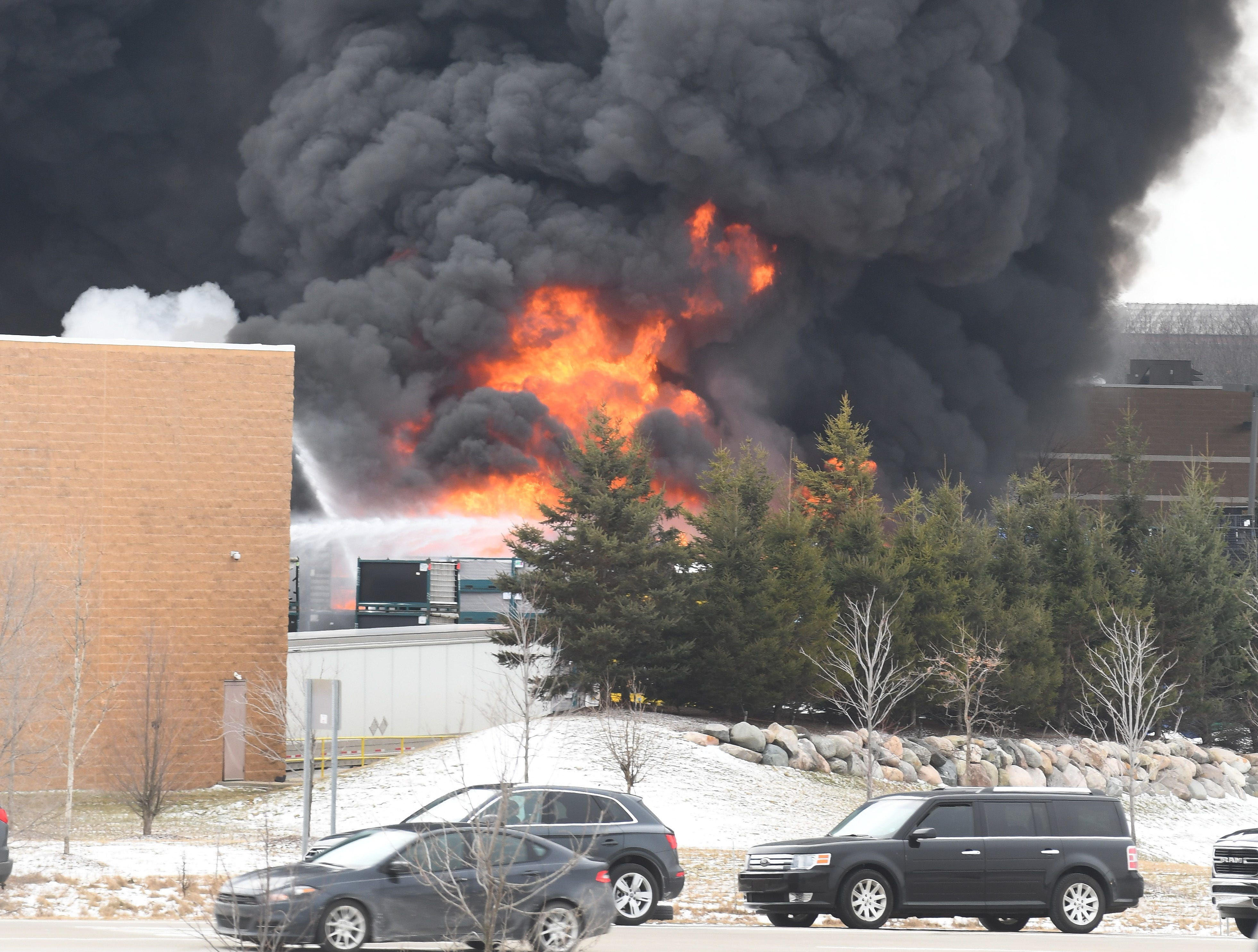 Fire rages at U.S. Farathane, a plastics manufacturer in Auburn Hills, around noon on Tuesday, February 26, 2019.