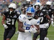 Memphis running back Darrell Henderson, center, averaged 8.9 yards per carry last season.