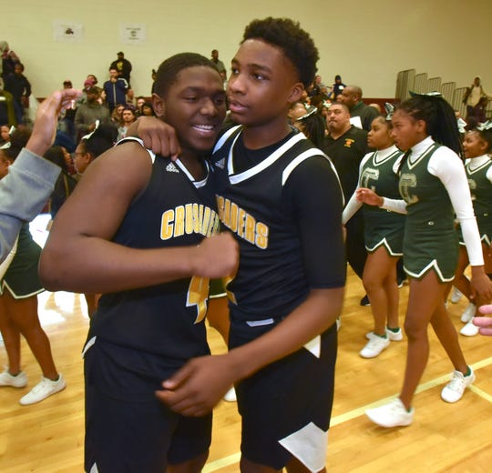 Detroit King teammates Keith Tate and Chancey Willis congratulate each other after their win over Detroit Cass Tech.