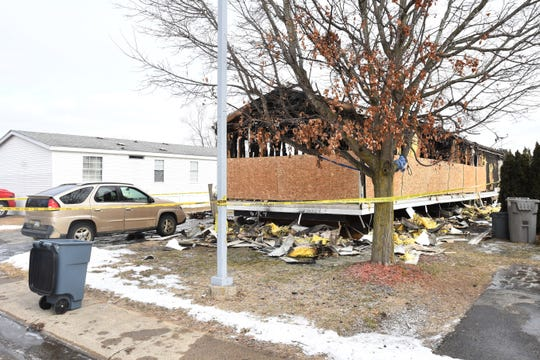 The remains of a mobile home are seen in Imlay City, where three children died in a Tuesday morning fire.