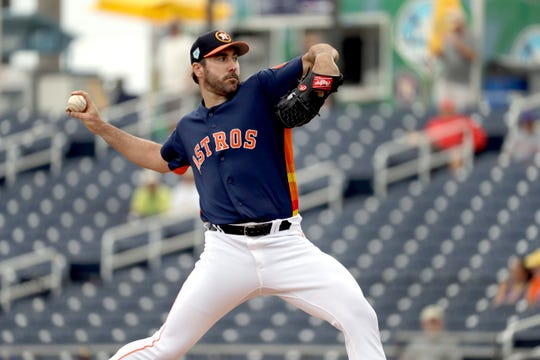 Houston Astros starting pitcher Justin Verlander throws during the first inning of an exhibition game Monday.