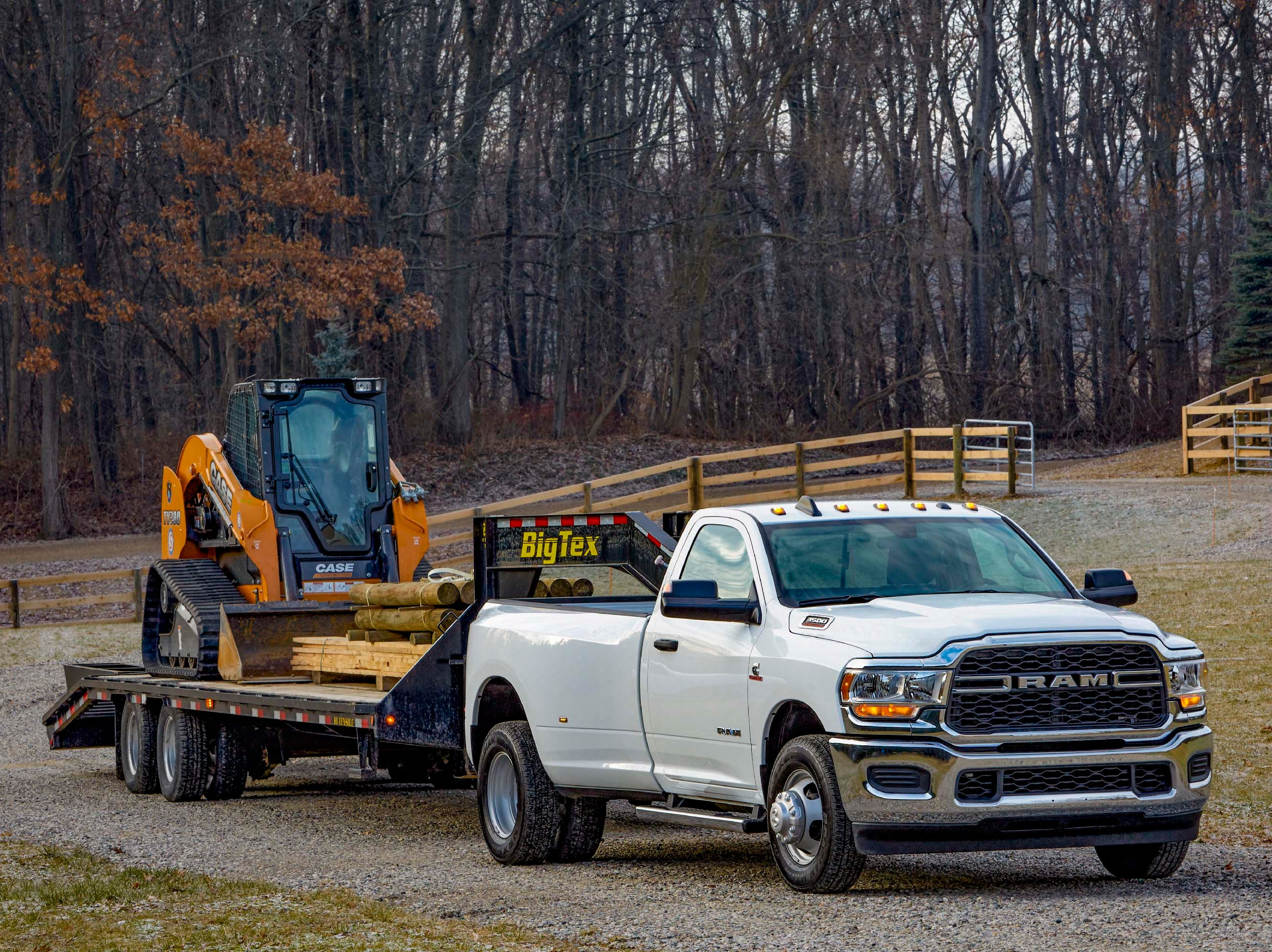 Give me a challenge. The Ram 3500 (here in base, regular cab, Tradesman trim) cleans and jerks trailers, equipment and homes weighing over 30,000 pounds. Credit a lightweighted chassis and Cummins diesel brute under the hood.