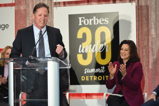 Forbes CEO Mike Federle announces that Forbes will hold their Under 30 summit in the Detroit for several years. Gov. Gretchen Whitmer, right, was in attendance.