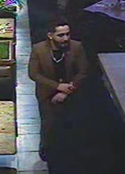 Dearborn Police are seeking two people of interest in an incident in which several gunshots were fired at a car in a restaurant parking lot on Jan. 5, 2019.