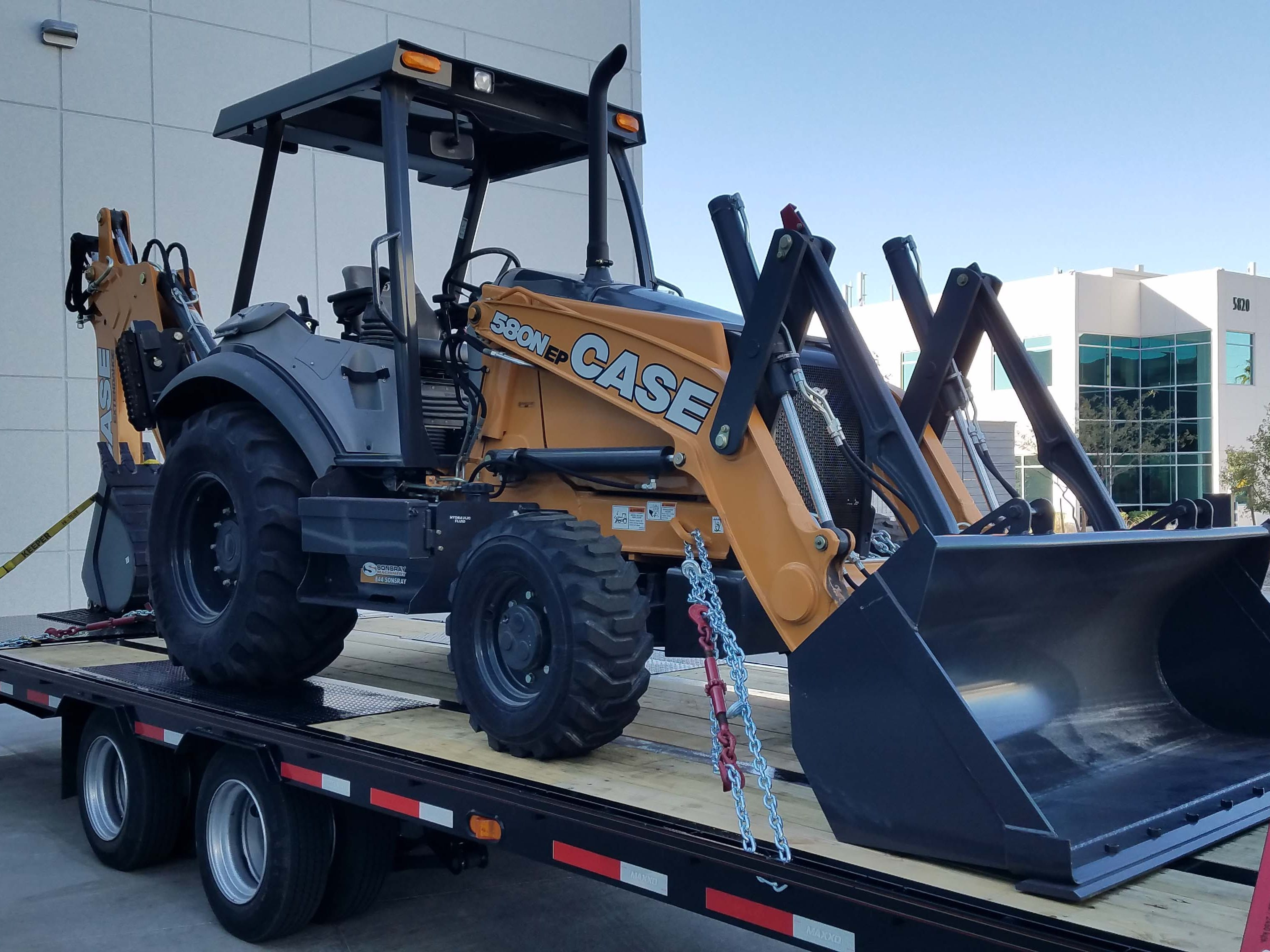 Have Ram 3500 Heavy Duty, will travel. This backhoe is part of a 35,100-pound package that sets a record for HD towing.