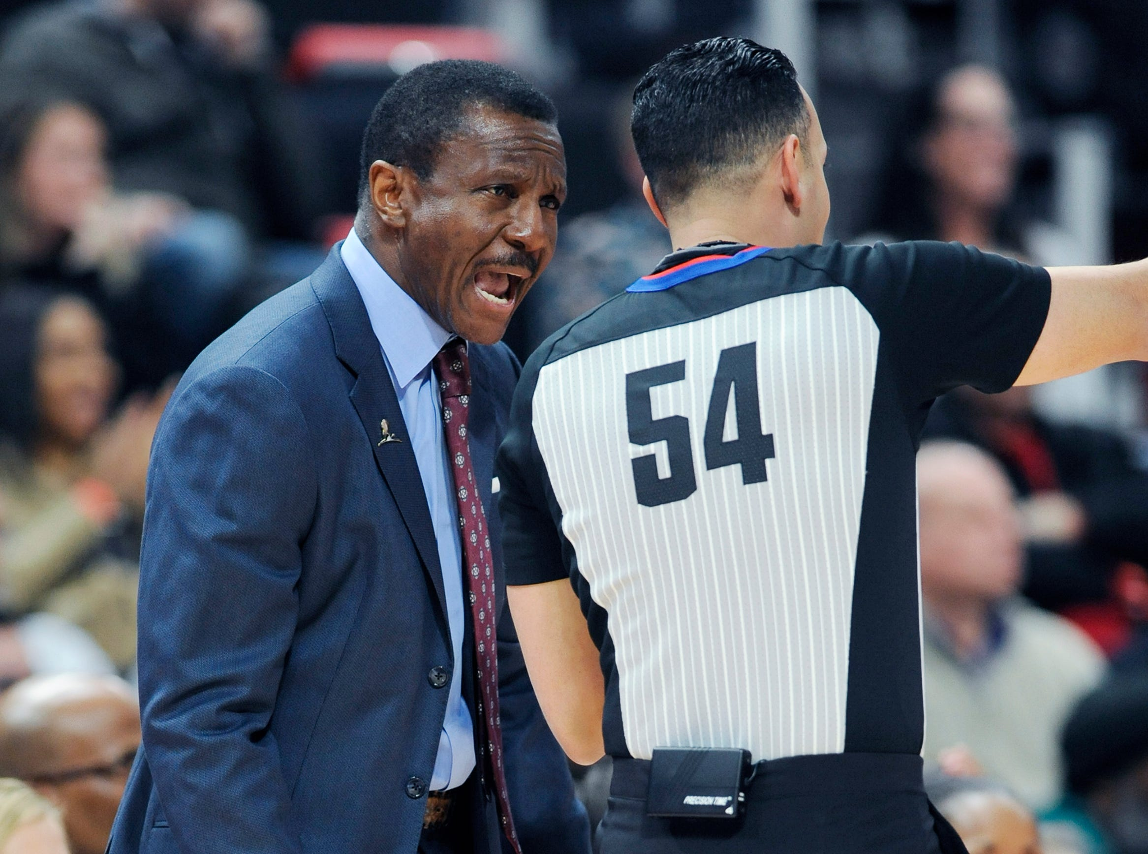 Pistons coach Dwane Casey yells at referee Ray Acosta in the third quarter.