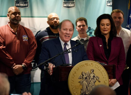Detroit Mayor Mike Duggan (center), along with Michigan Gov. Gretchen Whitmer (right)  and several FCA employees announce that FCA will be building a new assembly plant in Detroit.