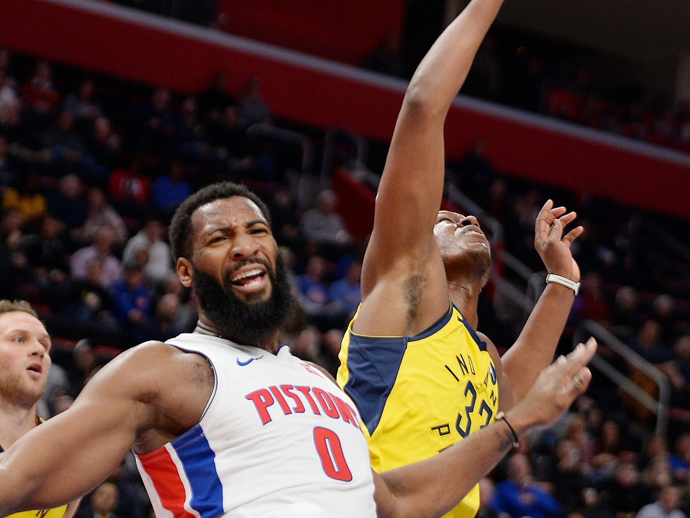 Detroit's Andre Drummond collides with Myles Turner after a shot attempt in the second quarter.