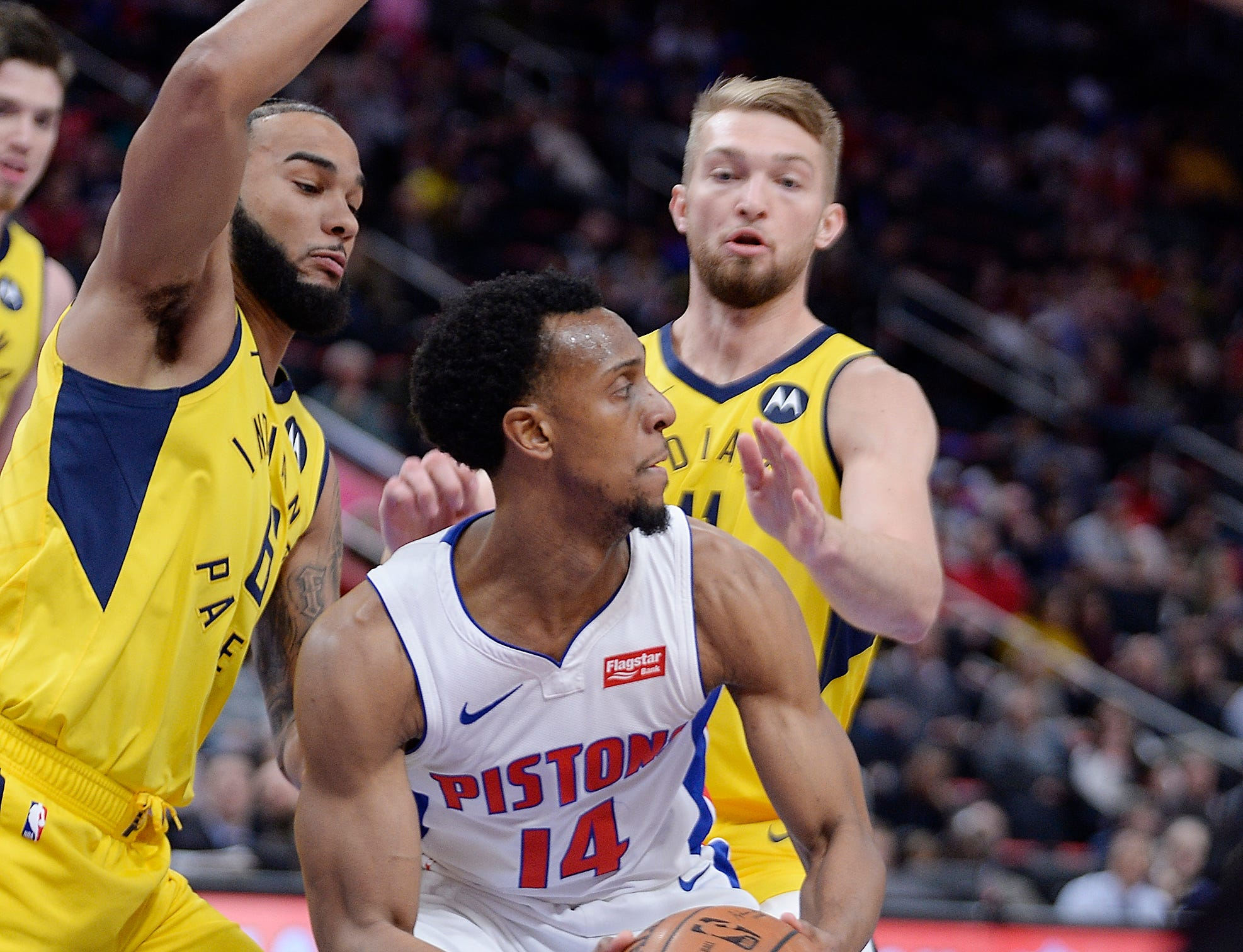 Detroit's Ish Smith looks for room around Cory Joseph, left, and Domantas Sabonis in the second quarter.