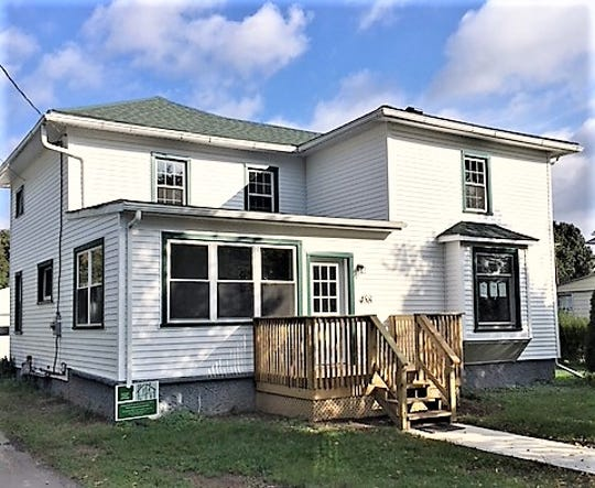 The Chemung County Land Bank recently sold this formerly abandoned house on Tompkins Street in Elmira for more than $84,000 after rehabilitating it.